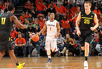 Dec. 17, 2010; Charlottesville, VA, USA; Virginia Cavaliers guard Jontel Evans (1) makes his way down court between Oregon Ducks guard Malcolm Armstead (11) and Oregon Ducks forward E.J. Singler (25) during the game at the John Paul Jones Arena. Virginia won 63-48. Mandatory Credit: Andrew Shurtleff-