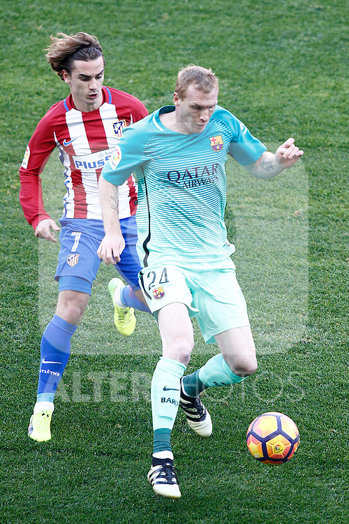 Atletico de Madrid's Antoine Griezmann (l) and FC Barcelona's Jeremy Mathieu during La Liga match. February 26,2017. (ALTERPHOTOS/Acero)