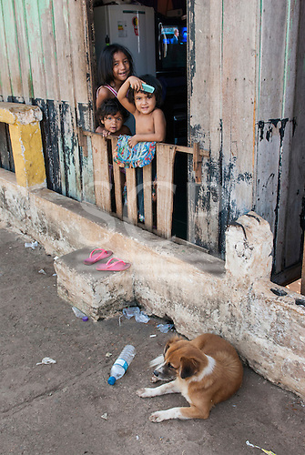 Altamira port, Para State, Brazil. Poor home with children and dog.