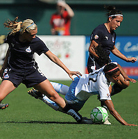 Chicago Red Stars midfielder Chioma Igwe (12) goes down in a foul by Washington Freedom midfielder Allie Long (9) and Lisa De Vanna (17).  Washington Freedom tied with The Chicago Red Stars 0-0  at RFK Stadium, Saturday June 13, 2009.