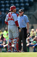 Hagerstown Suns catcher Spencer Kieboom (20) argues a call with home plate umpire Cody Waterhouse during a game against the Lexington Legends on May 19, 2014 at Whitaker Bank Ballpark in Lexington, Kentucky.  Lexington defeated Hagerstown 10-8.  (Mike Janes/Four Seam Images)