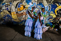 Samba school dancers prepare their costumes before entering the Carnival parade at the Sambadrome in Rio de Janeiro, Brazil, 20 February 2012. The Carnival in Rio de Janeiro, considered the biggest carnival in the world, is a colorful, four day celebration, taking place every year forty days before Easter. The Samba school parades, featuring thousands of dancers, imaginative costumes and elaborate floats, are held on the Sambadrome, a purpose-built stadium in downtown Rio. According to costumes, flow, theme, band music quality and performance, a single school is declared the winner of the competition.
