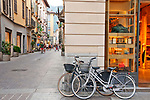 Bikes on the corner of a shopping street in downtown Como, Italy on Lake Como