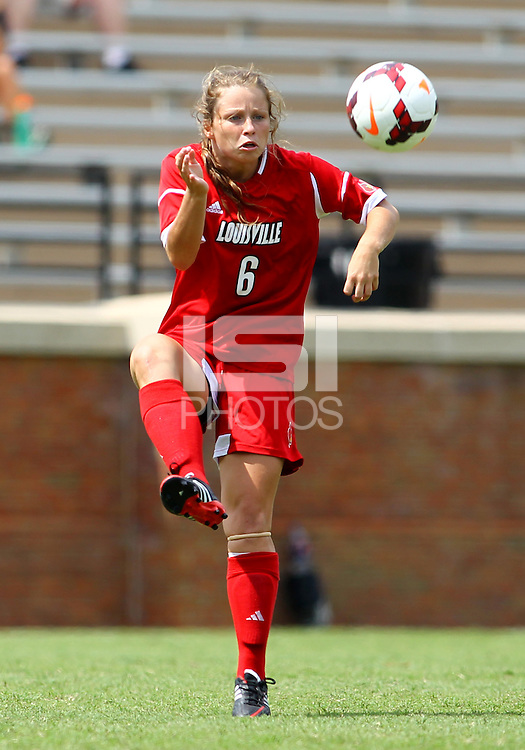 WINSTON-SALEM, NORTH CAROLINA - September 01, 2013:<br /> Shannon Dennehey (6) of Louisville University pulls in a high ball against Wake Forest University during a match at the Wake Forest Invitational tournament at Wake Forest University on September 01. The match was abandoned early in the second half due to severe weather with Wake leading 1-0.