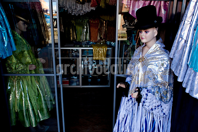 """Aymara Women fashion shop, traditional """"Cholita"""" outfits.Just 25 years ago it was a small group of houses around La Paz  airport, at an altitude of 12,000 feet. Now El Alto city  has  nearly one million people, surpassing even the capital of Bolivia, and it is the city of Latin America that grew faster ...It is also a paradigmatic city of the troubles  and traumas of the country. There got refugee thousands of miners that lost  their jobs in 90 ¥s after the privatization and closure of many mines. The peasants expelled by the lack of land or low prices for their production. Also many who did not want to live in regions where coca  growers and the Army  faced with violence...In short, anyone who did not have anything at all and was looking for a place to survive ended up in El Alto...Today is an amazing city. Not only for its size. Also by showing how its inhabitants,the poorest of the poor in one of the poorest countries in Latin America, managed to get into society, to get some economic development, to replace their firs  cardboard houses with  new ones made with bricks ,  to trace its streets,  to raise their clubs, churches and schools for their children...Better or worse, some have managed to become a sort of middle class, a section of the society that sociologists call  emerging sectors. Many, maybe  most of them, remain for statistics as  poor. But clearly  all of them have the feeling they got  for their children a better life than the one they had to face themselves ."""
