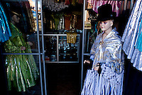 "Aymara Women fashion shop, traditional ""Cholita"" outfits.Just 25 years ago it was a small group of houses around La Paz  airport, at an altitude of 12,000 feet. Now El Alto city  has  nearly one million people, surpassing even the capital of Bolivia, and it is the city of Latin America that grew faster ...It is also a paradigmatic city of the troubles  and traumas of the country. There got refugee thousands of miners that lost  their jobs in 90 ¥s after the privatization and closure of many mines. The peasants expelled by the lack of land or low prices for their production. Also many who did not want to live in regions where coca  growers and the Army  faced with violence...In short, anyone who did not have anything at all and was looking for a place to survive ended up in El Alto...Today is an amazing city. Not only for its size. Also by showing how its inhabitants,the poorest of the poor in one of the poorest countries in Latin America, managed to get into society, to get some economic development, to replace their firs  cardboard houses with  new ones made with bricks ,  to trace its streets,  to raise their clubs, churches and schools for their children...Better or worse, some have managed to become a sort of middle class, a section of the society that sociologists call  emerging sectors. Many, maybe  most of them, remain for statistics as  poor. But clearly  all of them have the feeling they got  for their children a better life than the one they had to face themselves ."