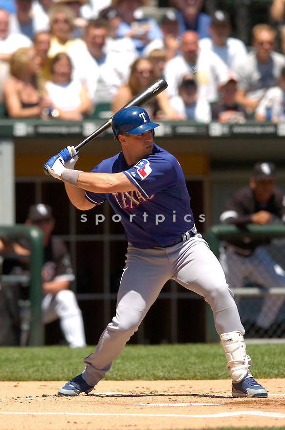 Mark Teixeira in action during the Texas Rangers v. Chicago White Sox game on June 4, 2006. ..Rangers win 10-2..Chris Bernacchi / SportPics