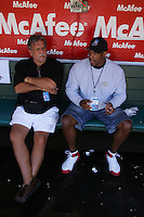 OAKLAND, CA - SEPTEMBER 4: Photographers Mickey Palmer and Thearon Henderson talk in the dugout before the game between the New York Yankees and Oakland Athletics at the Oakland-Alameda County Coliseum in Oakland, California on September 4, 2005. Photo by Brad Mangin