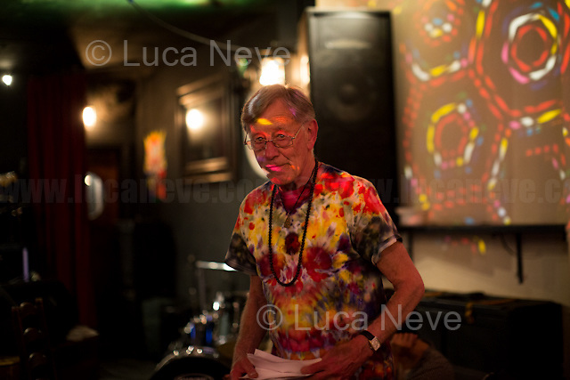 London, 23/07/2016. Documenting the performance of the Poet Lee Harris accompanied by Ben River (Electronics) &amp; Paul Bangash (Guitar) at the Mau Mau Bar in Portobello, &quot;An evening of music, magick, wit, words &amp; high weirdness&quot;.<br /> <br /> For more information about the Artist please click here: https://en.wikipedia.org/wiki/Lee_Harris_(South_African_artist) &amp; http://www.homegrownmagazine.co.uk/<br /> <br /> For videos of the The Moonlight Orchestra feat Lee Harris please click here: https://www.youtube.com/channel/UCGQwGNgjuTvyOOn8ccuJWWA/videos