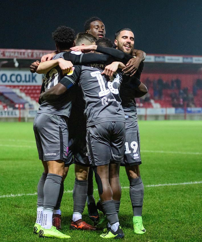 Lincoln City's Matt Green, left, celebrates scoring the opening goal with team-mates<br /> <br /> Photographer Andrew Vaughan/CameraSport<br /> <br /> The EFL Checkatrade Trophy Second Round - Accrington Stanley v Lincoln City - Crown Ground - Accrington<br />  <br /> World Copyright © 2018 CameraSport. All rights reserved. 43 Linden Ave. Countesthorpe. Leicester. England. LE8 5PG - Tel: +44 (0) 116 277 4147 - admin@camerasport.com - www.camerasport.com