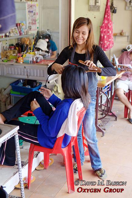 Woman Giving Haircut At Little Boy At Phsar Nath Market