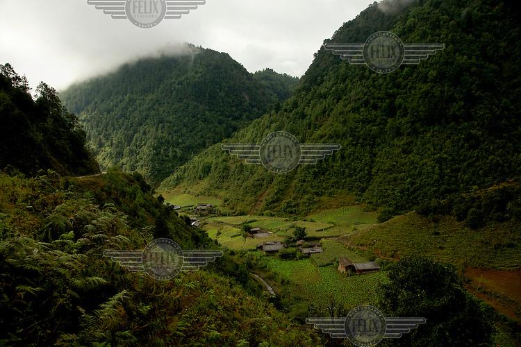 Verdant hillsides rise above a mountain village near the legendary Lugu Hu Lake. /Felix Features