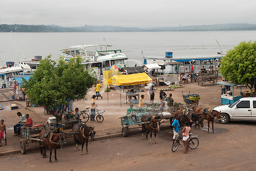 Itaituba, Amazon, Tapajos river, Para State, Brazil. Port with boats vendors and horse and carts.