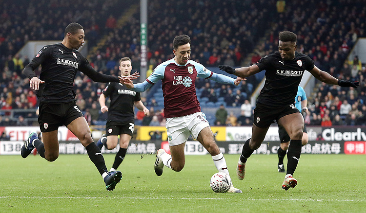 Burnley's Dwight McNeil battles with Barnsley's Ethan Pinnock (left) and Dimitri Cavare<br /> <br /> Photographer Rich Linley/CameraSport<br /> <br /> Emirates FA Cup Third Round - Burnley v Barnsley - Saturday 5th January 2019 - Turf Moor - Burnley<br />  <br /> World Copyright © 2019 CameraSport. All rights reserved. 43 Linden Ave. Countesthorpe. Leicester. England. LE8 5PG - Tel: +44 (0) 116 277 4147 - admin@camerasport.com - www.camerasport.com