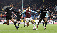 Burnley's Dwight McNeil battles with Barnsley's Ethan Pinnock (left) and Dimitri Cavare<br /> <br /> Photographer Rich Linley/CameraSport<br /> <br /> Emirates FA Cup Third Round - Burnley v Barnsley - Saturday 5th January 2019 - Turf Moor - Burnley<br />  <br /> World Copyright &copy; 2019 CameraSport. All rights reserved. 43 Linden Ave. Countesthorpe. Leicester. England. LE8 5PG - Tel: +44 (0) 116 277 4147 - admin@camerasport.com - www.camerasport.com