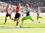 Nederland, Rotterdam, 28 oktober 2012.Eredivisie.Seizoen 2012-2013.Feyenoord-Ajax.Christian Eriksen van Ajax scoort de 0-1. Joris Mathijsen (l.) en Stefan de Vrij (2e van links) van Feyenoord kunnen hem niet afstoppen.