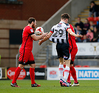 Leyton Orient's Tom Parkes and Grimsby Town's Calum Dyson grapple during the Sky Bet League 2 match between Leyton Orient and Grimsby Town at the Matchroom Stadium, London, England on 11 March 2017. Photo by Carlton Myrie / PRiME Media Images.