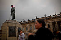 A Bolivar's monument is seen with a scarf in front of the National palace while people take part in a march supporting prostitution in Bogota, Colombia. 25/02/2012.  Photo by Eduardo Munoz Alvarez / VIEWpress.