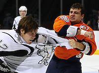 Tigers center Michael Haley (18) takes a swing at San Antonio's Steven Goertzen (12) during the first period of the AHL game between the Bridgeport Sound Tigers and the San Antonio Rampage, Nov. 18, 2008, at the AT&T Center in San Antonio. (Darren Abate/pressphotointl.om)