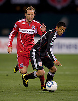 Justin Mapp (21) of the Chicago Fire tries to catch up to Andy Najar (14) of DC United at RFK Stadium in Washington, DC.  The Chicago Fire defeated DC United, 2-0.
