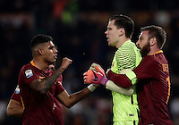 Calcio, Serie A: Roma vs Milan. Roma, stadio Olimpico, 12 dicembre 2016.<br /> Roma&rsquo;s goalkeeper Wojciech Szczesny, center, is hugged by teammates Emerson Palmieri, left, and Daniele De Rossi after saving a penalty kicked by Milan's M'Baye Niang, not seen, during the Italian Serie A football match between Roma and AC Milan at Rome's Olympic stadium, 12 December 2016.<br /> UPDATE IMAGES PRESS/Isabella Bonotto