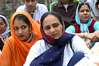 """Rome April 30 2006  .Piazza Vittorio  .Sikh """"Punj Pyare"""" (Five Beloved Ones) lead a religious parade.The parade is for Visaki, a traditional Sikh celebration..Women Sikh ."""