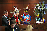 Lt. Gov. Mark Hutchison, left, listens as Paiute Tribal Elder Ralph Burns leads the Senate in prayer as part of Nevada Tribes Day at the Legislative Building in Carson City, Nev., on Tuesday, Feb. 10, 2015.  John D. Rupert, 13, and his father Ben Rupert are at right.<br /> Photo by Cathleen Allison