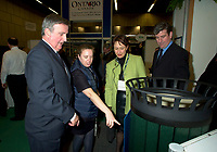 Montreal, march 28 , 2001 File Photo<br />  Montreal Mayor ;Pierre Bourque (L) visit the innovation booth at Americana 2001 conference and trade show on environmental technologies and waste management march 28, 2001 in Montreal, CANADA.<br /> <br /> Bourque is currentlyrunning for reelection against former Quebec Minister Gerald Tremblay<br /> <br /> Photo by Pierre Roussel / Alpha-Presse<br /> NOTE :  D-1 Uncorrected JPEG opened with QUIMAGE profile, saved in Adobe 1998 RGB color space