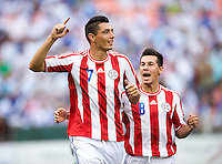 Oscar Cardozo (7) of Paraguay celebrates his goal with teammate Hernan Perez (8) during the game at RFK Stadium in Washington, DC.  Guatemala tied Paraguay, 3-3.