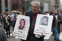A man protests alleged child abuse by the Catholic church during the NYC Easter Parade.