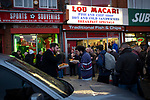 Fans congregating outside fast food outlets before Manchester United hosted Manchester City at Old Trafford. This was the 178th time the sides had met, with City looking to overtake rivals Liverpool in the race for the English Premier League title. City won the match 2-0 watched by 74,431 spectators.