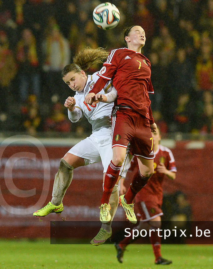 20151130 - LEUVEN ,  BELGIUM : Belgian Elke Van Gorp (7) pictured in a duel with Serbian Jelena Cankovic (10) during the female soccer game between the Belgian Red Flames and Serbia , the third game in the qualification for the European Championship in The Netherlands 2017  , Monday 30 November 2015 at Stadion Den Dreef  in Leuven , Belgium. PHOTO DAVID CATRY