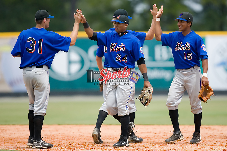 Nicholas Giarraputo (31) Donald Green (24) and Greg Veloz (15) congratulate each other following the Kingsport Mets 5-3 win over the Burlington Royals at Burlington Athletic Park in Burlington, NC, Monday, July 30, 2007.