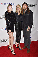 LOS ANGELES, CA - FEBRUARY 08: (L-R) Miley Cyrus, Tish Cyrus and Billy Ray Cyrus attend MusiCares Person of the Year honoring Dolly Parton at Los Angeles Convention Center on February 8, 2019 in Los Angeles, California.<br /> CAP/ROT/TM<br /> &copy;TM/ROT/Capital Pictures