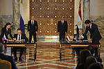 Egyptian President Abdel-Fattah al-Sisi (R, back) and his visiting counterpart Vladimir Putin (L, back) witness the signing of an agreement to build Egypt's first nuclear power plant in Cairo, Egypt on Dec. 11, 2017. Photo by Egyptian President Office
