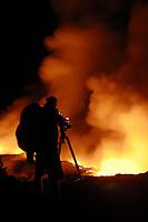 Videographer, lava flow at the Waikupanaha ocean entry, Hawaii, Big Island of Hawaii