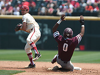 NWA Democrat-Gazette/J.T. WAMPLER Jack Kenley makes the throw to first for a double play after catching Texas A&M's Allonte Wingate at second Sunday May 13, 2018 at Baum Stadium in Fayetteville. Arkansas won 6-3 to sweep the three game series.