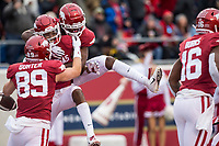 Hawgs Illustrated/BEN GOFF <br /> Grayson Gunter (from left), Trey Knox and Mike Woods of Arkansas celebrate after Knox caught a touchdown pass in the first quarter vs Missouri Saturday, Nov. 29, 2019, at War Memorial Stadium in Little Rock.