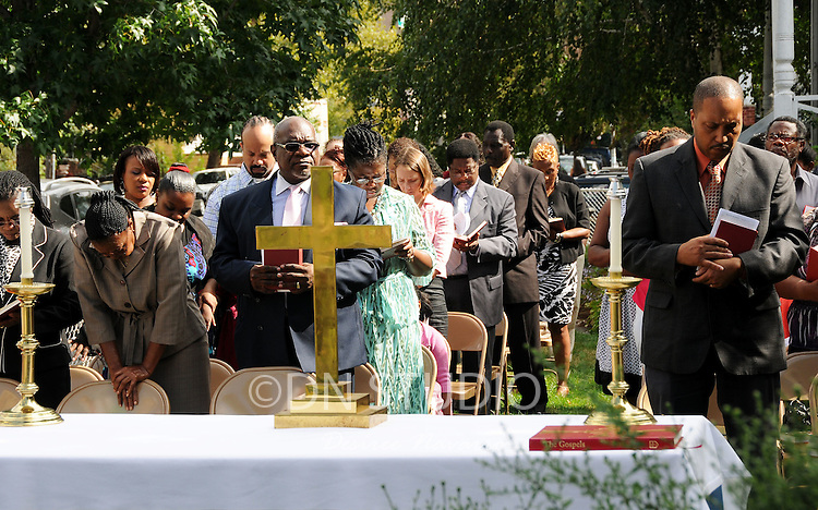 Parishioners during an outdoor worship service at the Church of the Holy Apostles in Brooklyn on Sunday, September 19, 2010.
