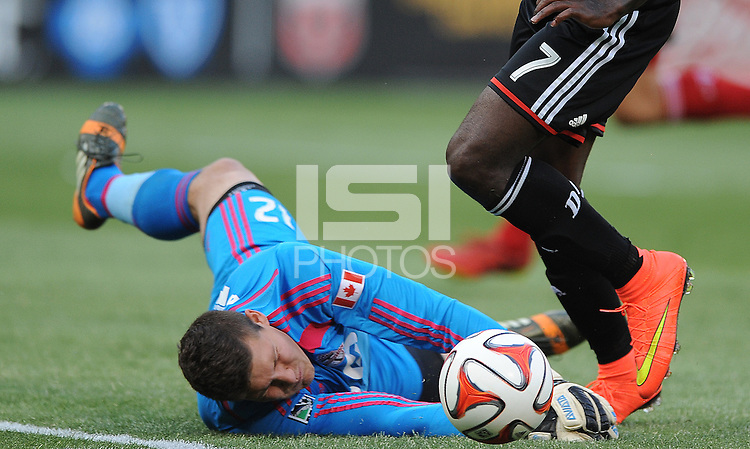 Washington D.C. - July 30, 2014: Joseph Bendik (12) of Toronto FC goes down to make a save.  D.C. United defeated the Toronto FC 3-1 during a Major League Soccer match for the 2014 season at RFK Stadium.