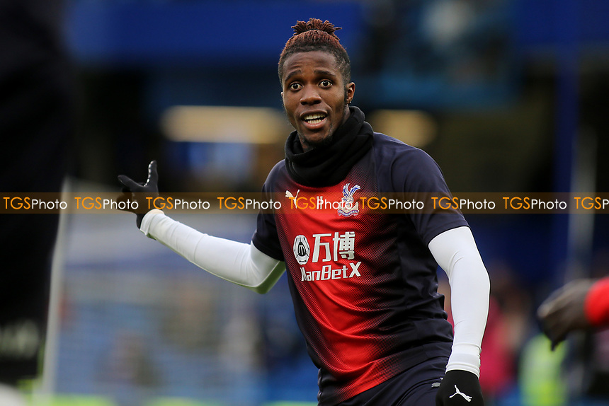 Wilfried Zaha of Crystal Palace warms up ahead of kick-off during Chelsea vs Crystal Palace, Premier League Football at Stamford Bridge on 4th November 2018