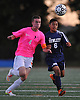 Manhasset No. 4 Kurt Wesch, left, and Hewlett No. 6 Joel Caceres battle for possession during a Nassau County varsity boys' soccer game at Manhasset High School on Thursday, October 15, 2015. Manhasset won by a score of 2-0.<br /> <br /> James Escher