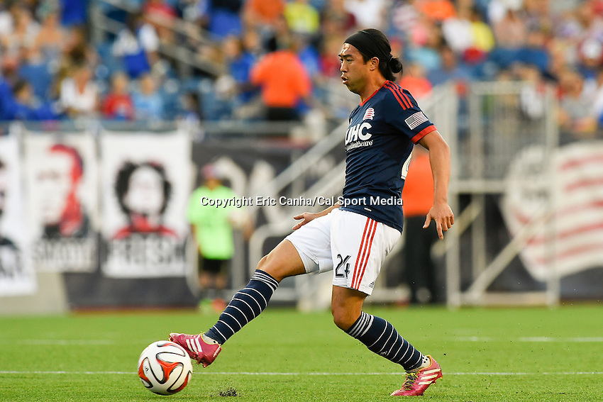 June 28, 2014 - Foxborough, Massachusetts, U.S. - New England Revolution midfielder Lee Nguyen (24) passes the ball during the MLS game between the Philadelphia Union and the New England Revolution held at Gillette Stadium in Foxborough Massachusetts.  Philadelphia defeated New England 3-1.  Eric Canha/CSM