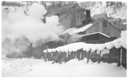 Two RGS engines switching one of the mills at Pandora in deep snow.<br /> RGS  Pandora, CO  Taken by Rasmussen, Forest - ca. 1940-1949