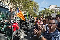 Protest through the centre of Barcelona called by agricultural trade unions and rural cooperatives in support of the independence referendum. The convoy of tractors and agricultural appliances numbered about 100 as it passed the university. 29-9-17
