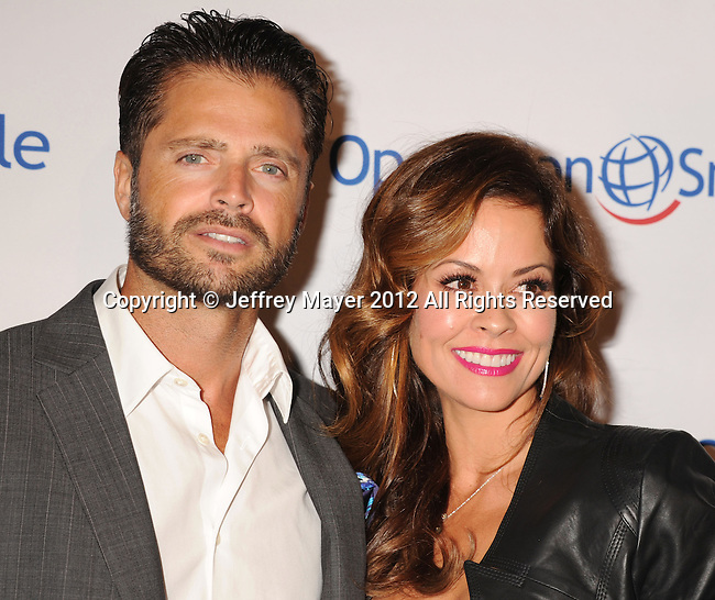 BEVERLY HILLS, CA - SEPTEMBER 28: David Charvet and Brooke Burke-Charvet attend Operation Smile's 30th Anniversary Smile Gala - Arrivals at The Beverly Hilton Hotel on September 28, 2012 in Beverly Hills, California.