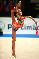 Maryia Yushkevich of Belarus holds clubs balance with with free leg bent (back) at 2006 Portimao World Cup of Rhythmic Gymnastics on September 10, 2006 at Portimao, Portugal.  (Photo by Tom Theobald)