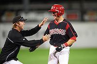 Batavia Muckdogs pitcher Steven Farnworth (left) jumps on Blake Anderson (26) after a game winning walk off hit during a game against the Williamsport Crosscutters on August 27, 2015 at Dwyer Stadium in Batavia, New York.  Batavia defeated Williamsport 3-2.  (Mike Janes/Four Seam Images)