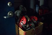 Helmets from the defunct Raleigh Rebels arena football team in storage at Dorton Arena in Raleigh, North Carolina on Tuesday, November 25, 2014. (Justin Cook)