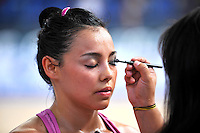 Rut Castillo of Mexico receives eye makeup from coach before 2010 Holon Grand Prix at Holon, Israel on September 3, 2010.  (Photo by Tom Theobald).